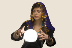 Fortune-teller with Crystal Ball. Gypsy fortune-teller uses a crystal ball to foretell the future stock photo