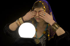 Fortune-teller with Crystal Ball. Gypsy fortune-teller uses a crystal ball to foretell the future royalty free stock images