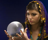 Fortune-teller with Crystal Ball. Gypsy fortune-teller uses a crystal ball to foretell the future royalty free stock photography