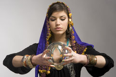 Fortune-teller with Crystal Ball. Gypsy fortune-teller uses a crystal ball to foretell the future royalty free stock photos