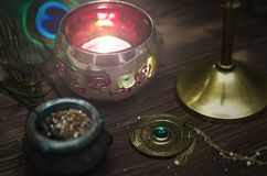Magic table. Paranormal desk. Witchcraft. Fortune teller. Divination. Witchcraft. Magic table. Magic attributes. Mystic candle light Royalty Free Stock Photos