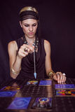 Fortune teller forecasting the future with pendulum Stock Photo