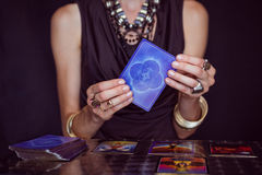 Fortune teller forecasting the future with tarot cards Stock Image