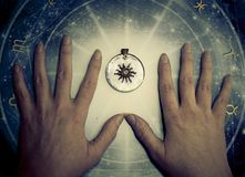 Fortune teller hands over horoscope with zodiac signs like astrology concept stock photography