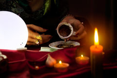 Fortune teller holds an empty coffee mug Royalty Free Stock Image