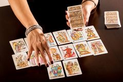 Fortune teller laying out a deck of tarot cards royalty free stock image