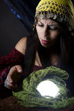 Fortune Teller Looking at Crystal Ball Royalty Free Stock Photography