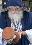 Fortune teller looking hour glass. Old man, fortune teller looking at hour glass stock photography