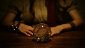 Fortune teller looks in the future and lifts thumb down. Female fortune teller looks in the future and lifts thumb down