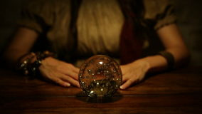 Fortune teller looks in the future and lifts thumb up. Female fortune teller looks in the future and lifts thumb up