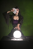 Fortune teller with playing cards and crystal ball royalty free stock images