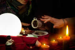 Fortune teller read a fortune from coffee mug Royalty Free Stock Image