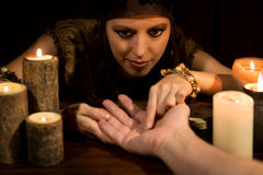 Fortune Teller is reading the lifeline and heart line, concept p. Female fortune Teller is reading the lifeline and heart line, concept palmistry Stock Image