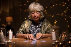 Fortune teller reading tarot cards Stock Photos