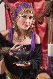 Fortune Teller Rubs the Lamp Royalty Free Stock Images