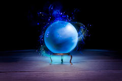 Fortune teller's Crystal Ball with dramatic lighting. Magic crystal ball on a table Royalty Free Stock Image