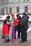 Fortune teller speaks to a couple. Shrovetide celebration in Moscow Stock Image