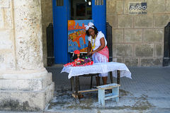 A fortune teller in the street of Havana with a suspicious look. Cuba, Havana - 07 April, 2016: a friendly cheerful fortune teller inviting to tell the destiny Stock Photo