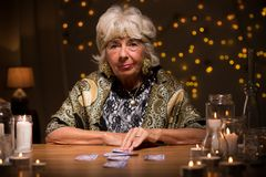 Fortune teller with tarot cards Royalty Free Stock Photo