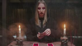 Fortune teller tarot reader placing cards in order as mystic rite.