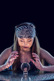 Fortune teller using crystal ball Royalty Free Stock Images