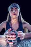 Fortune teller using crystal ball Stock Photos