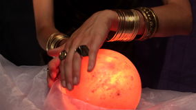 Fortune teller using crystal ball stock video