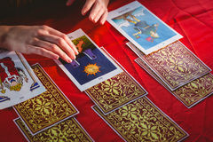 Fortune teller using tarot cards. On red table Royalty Free Stock Photo