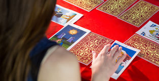 Fortune teller using tarot cards. On red table Stock Photo