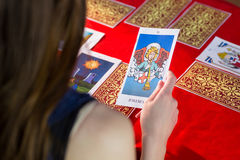 Fortune teller using tarot cards. On red table Royalty Free Stock Photography