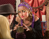 Fortune Teller Waving Hands. Over crystal ball royalty free stock photo