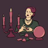 Fortune teller woman. With crystal ball and tarot Royalty Free Stock Image