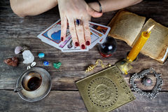 Fortune teller woman predicting future from cards Royalty Free Stock Photography