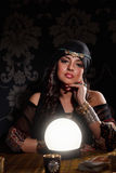 Fortune teller at work. Prophetess woman in costume with soothsayer sphere Stock Image