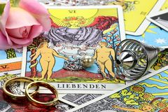 Fortune telling accessories. Pendulum and German tarot cards (the lovers Stock Photo
