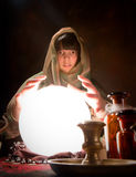 Fortune telling with a crystal ball Royalty Free Stock Images