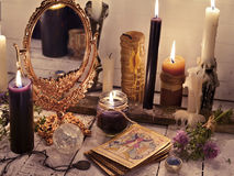 Fortune telling still life with the tarot cards, mirror and burning candles Royalty Free Stock Photography