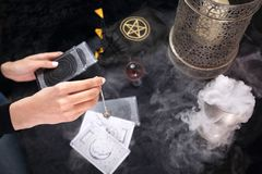 Tarot card. The fairy spreads the tarot cards, the magical meaning of the symbols. Fortune-telling from tarot cards. Fairy predicts the future by arranging royalty free stock image