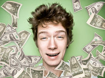 Fortuned guy with money rain Stock Images