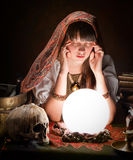 Fortuneteller with crystal ball. Diviner predicting the future with a crystal ball Royalty Free Stock Photos