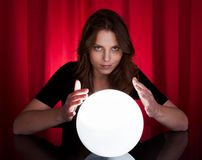 Fortuneteller with glowing ball Stock Photography