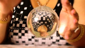 Fortuneteller moves on magic crystal ball hand stock video footage