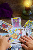 Fortunetelling with  Tarot cards. Fortunetelling with one of the most popular  occult Tarot  cards deck dating back 1910 Royalty Free Stock Images