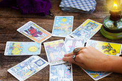 Fortunetelling with  Tarot cards. Fortunetelling with one of the most popular  occult Tarot deck dating back 1910 Royalty Free Stock Photo