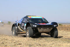 Forty Five degree close-up view of Speeding black CR-2 rally car Royalty Free Stock Images