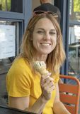 Forty five year old woman enjoying and ice cream cone on family vacation, Seattle, Washington. Pictured is a forty-five year old redheaded woman enjoying an ice stock images