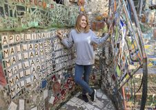 Forty-five yearold caucasian mother posing in the Magic Garden by Isaiah Zagar, Philadelphia. Pictured is a forty-five yearold Caucasian mother posing in the stock photo