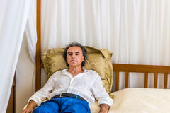 Forty rests on four poster bed Royalty Free Stock Photo