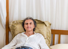 Forty rests on four poster bed Royalty Free Stock Photos