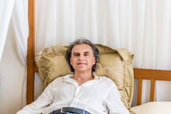 Forty rests on four poster bed Royalty Free Stock Image